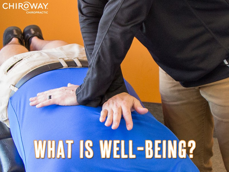 What is Well-being? Photo of man adjusting a person